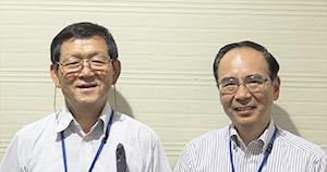尾家啓二社長(左)、野々村透執行役員
