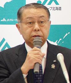 飛田稔章会長