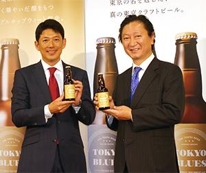 石川彌八郎社長(右)と津久浦慶明社長