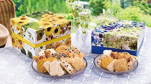 四季の花をパッケージにデザインしギフト商品として提案している「フルール」シリーズ。夏は「向日葵」(左)と「瑠璃」を発売