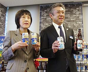 高橋はるみ北海道知事(左)と門田高明理事北海道統括本部長