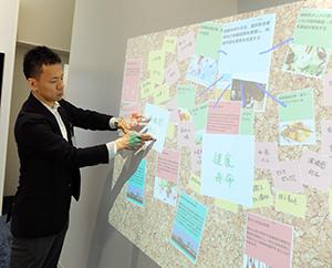 クライアントゾーンでは、同社技術の説明やそれに対するメモ書きもスキャニングしてスクリーンに映し出し自由に議論できる