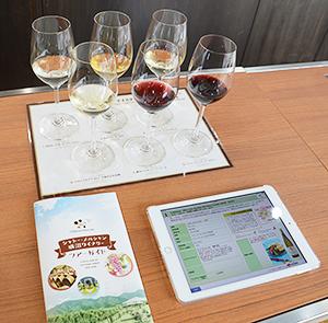 テイスティングはタブレット端末を使うことで、より詳しいワイン情報に触れられる
